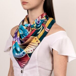 large brightly colored costa rican neckerchief worn on décolletage area .
