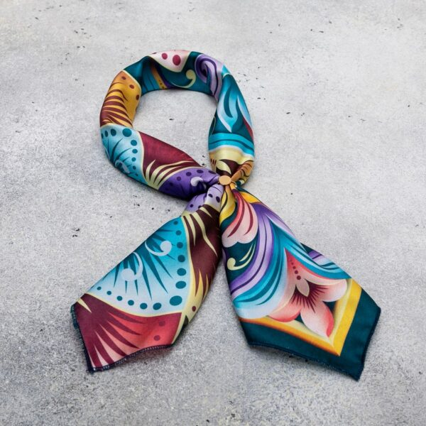 costa rican bright pattern scarf tied in loop.