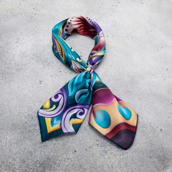 bright colored costa rican scarf tied in ribbon shape.