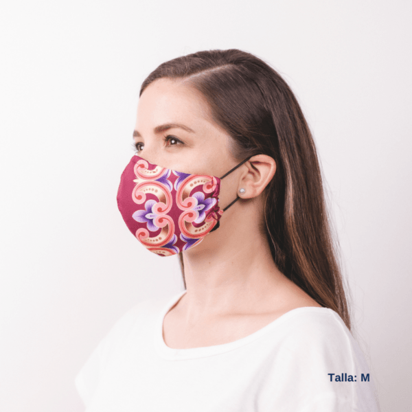 full sideview costa rican designed facemask worn by woman.