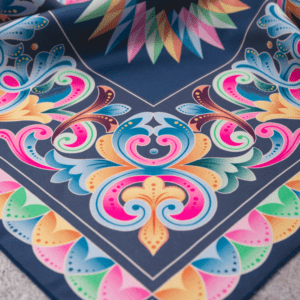 close up corner of peacock blue pastel colored costa rican handkerchief.