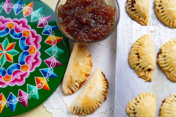 chiverre empanadas with side of jam and decorative plate