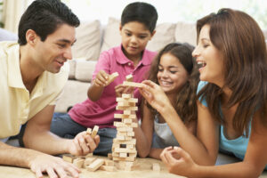 Family Playing Game Together At Home