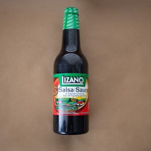 bottle of salsa lizano costa rica on brown kraft paper background