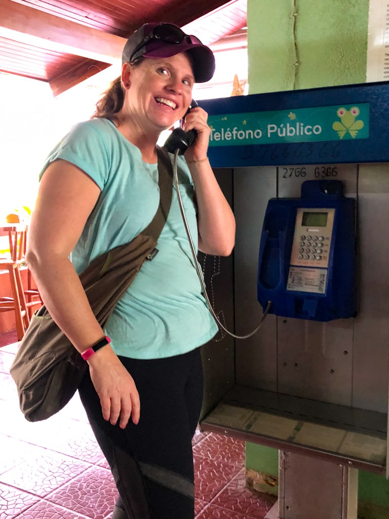 lady by pay phone