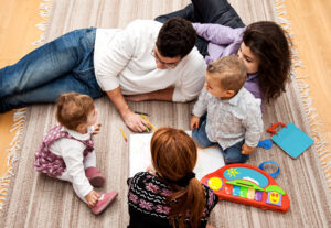 family on the floor playing