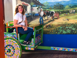 Christa sitting in sarchi costa rica pianted ox cart