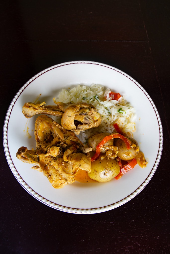 Costa Rican Chicken With Achiote with a black background