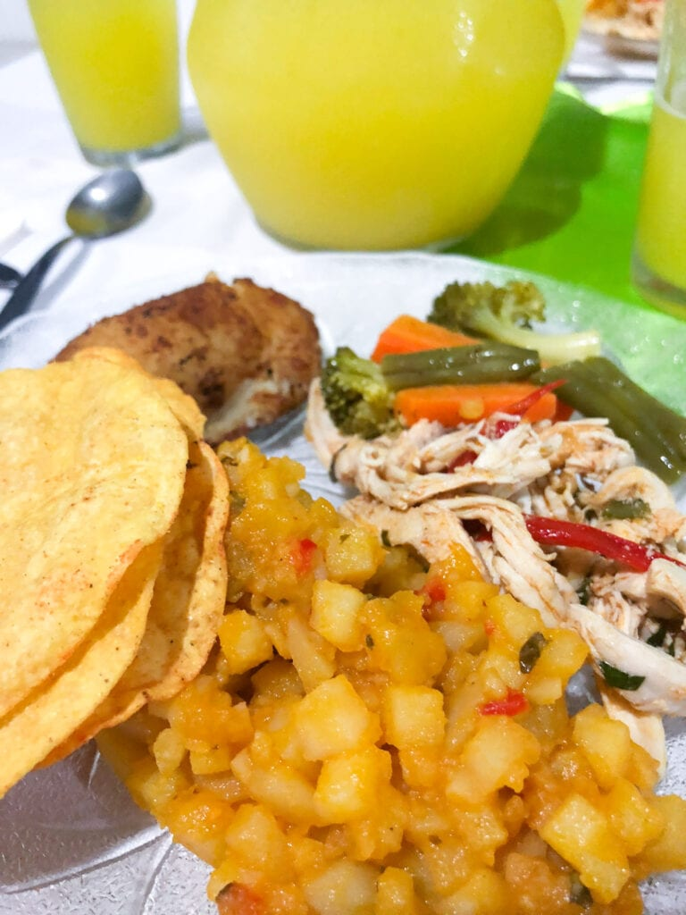costa rican potato hash served with shredded chicken and homemade yello corn tortillas