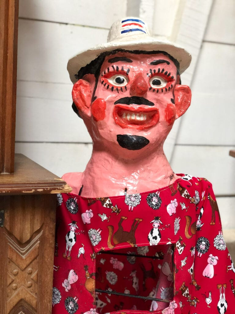 male costa rican mask with red shirt on