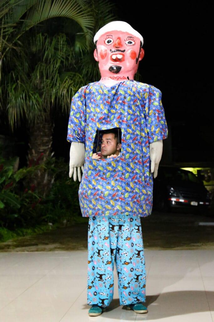 man standing inside a costa rican mask costume for dia de la mascarada
